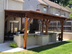 Outdoor Kitchen with Fireplace and Pergola